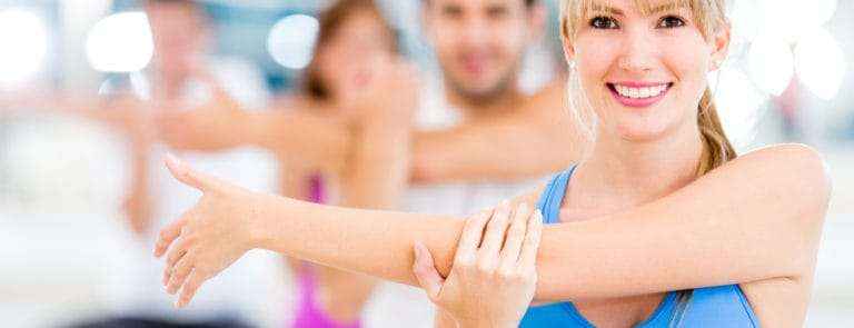 People Stretching in a gym class