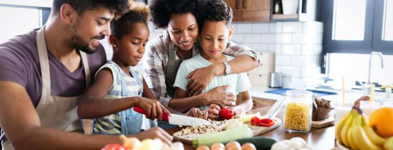 family cooking healthy foods together