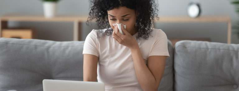 a woman struggling with a blocked nose