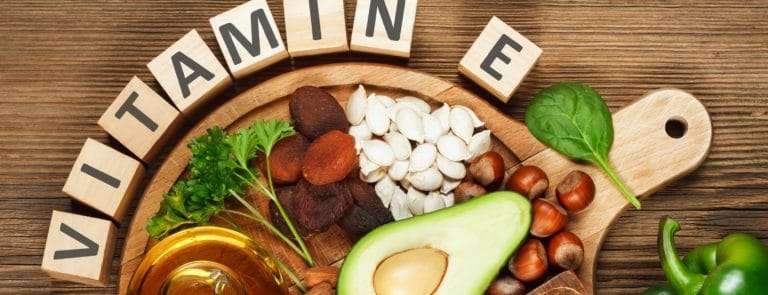 Vitamin E foods on a wooden surface