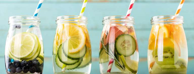 selection of glasses with fruit infused water