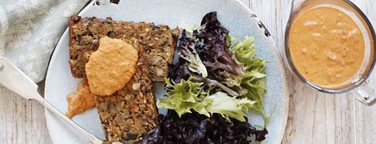 A plate of vegetable loaf with romesco sauce
