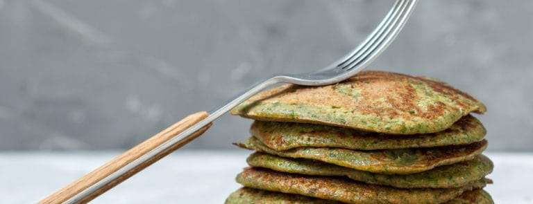 Green unusual spinach pancakes. Love for a healthy vegan food concept