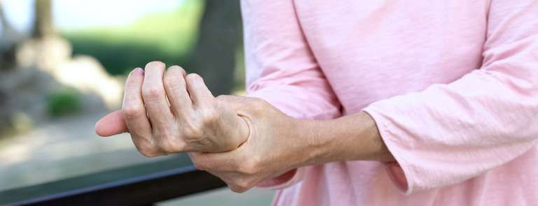 woman holding wrist joint pain