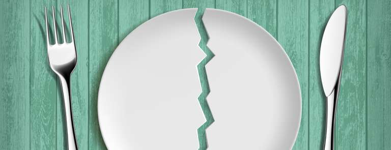 a broken plate with cutlery dieting concept