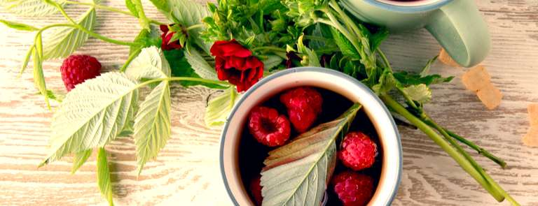raspberry tea with fresh fruit and leaves