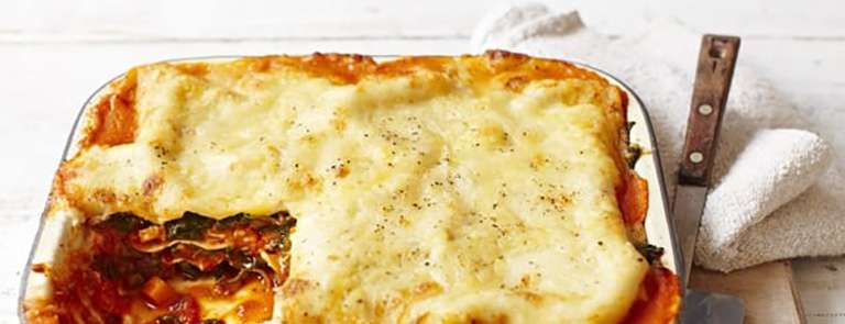 A squash and spinach lasagne in a dish