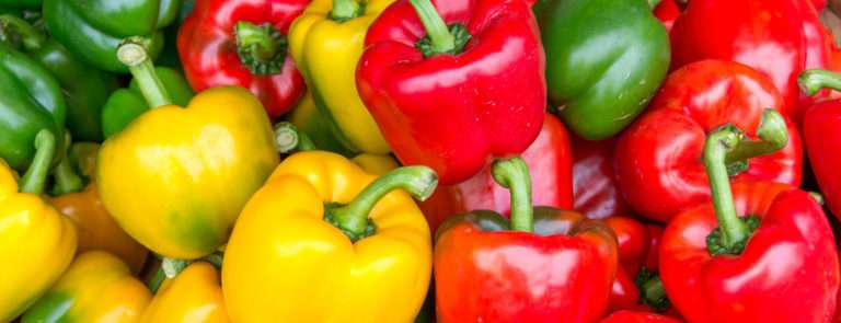 An array of red, yellow and green bell peppers.