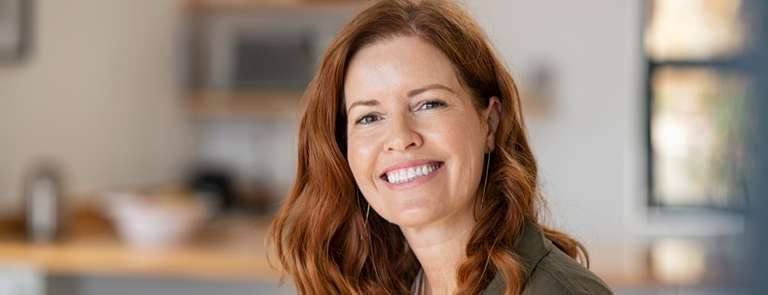 smiling mature woman going through menopause