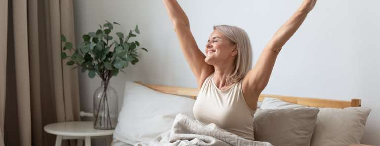 mature woman stretching happy