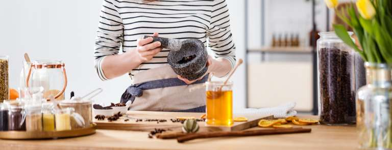 woman making diy beauty products at home with natural ingredients