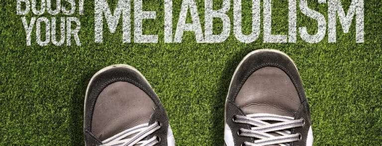 Trainers with boost your metabolism written in the grass