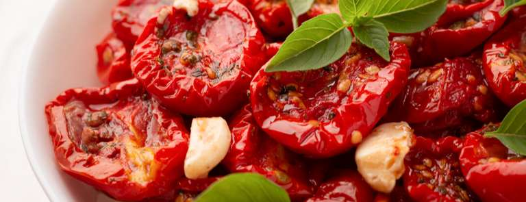sundried tomatoes in bowl with basil and garlic