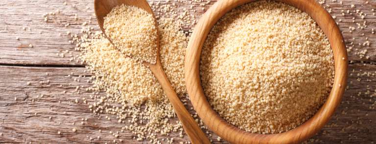 wooden bowl of raw couscous