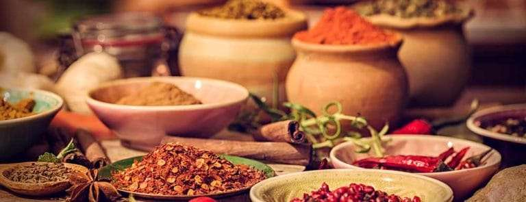 Lots of bowls containing various spices