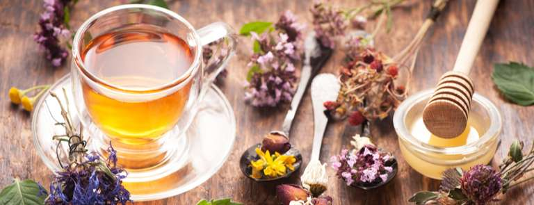herbal tea with dried flowers plants and honey