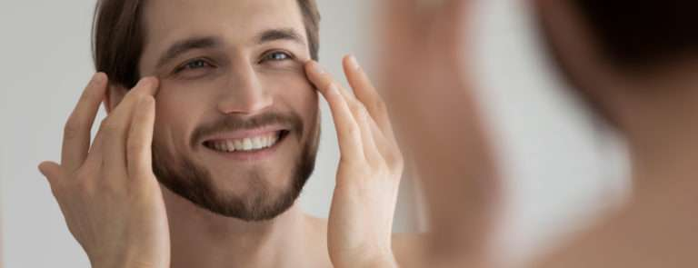 man applying the best eye cream for men