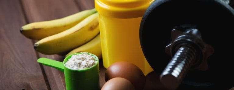 Shaker with a dumbbell, protein and protein food,