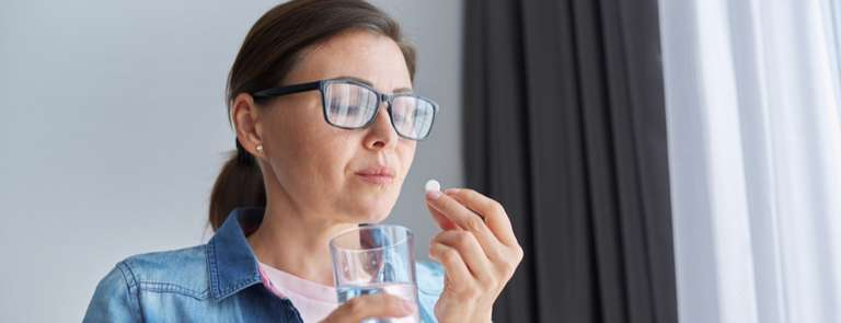 middle aged woman in menopause taking perimenopause supplements