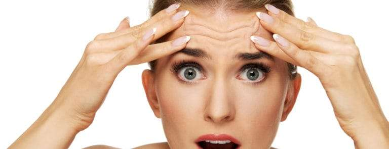Women with a shocked expression and wrinkles on her forehead