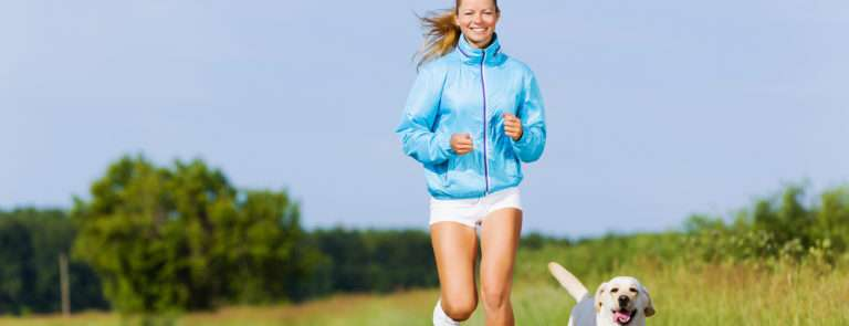 woman jogging with her per dog