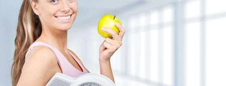 Women with apple and scales