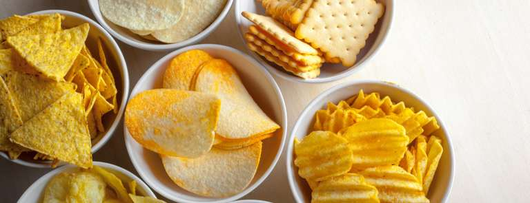 salty food crisps and crackers in bowls