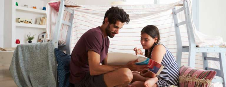 a father and daughter making a den at home