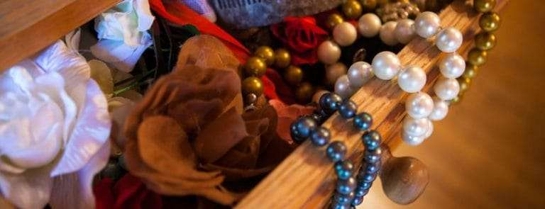 Various clutter in a draw such as Jewelry and fabrics