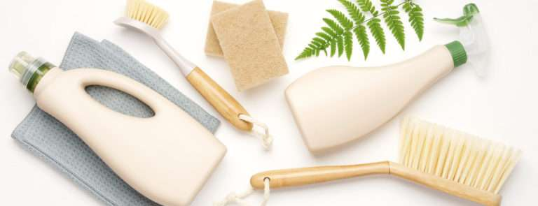 Foliage and eco-friendly cleaning bottles, sponges and brushes.