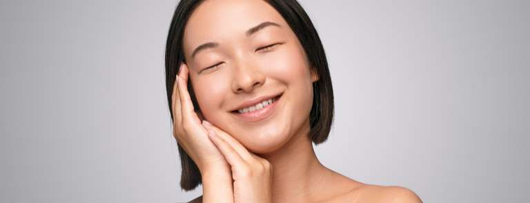 woman smiling with natural perfect skin