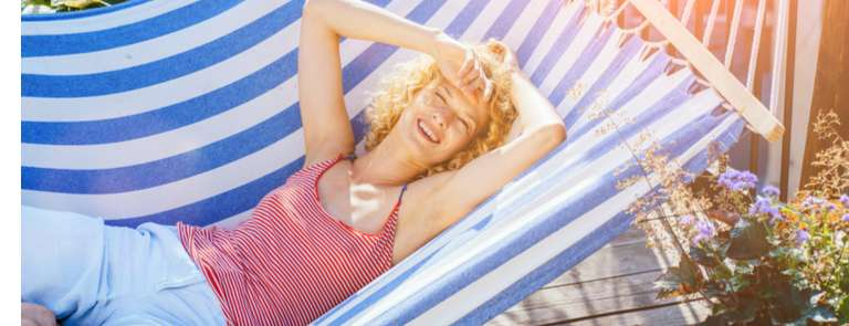 woman on hammock smiling in sun