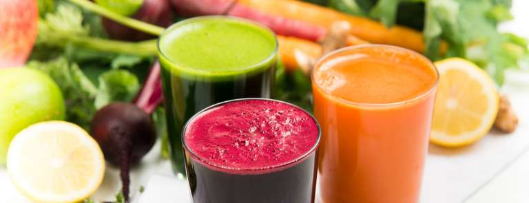 glasses of different fruit and vegetable juices for juice cleanse diet