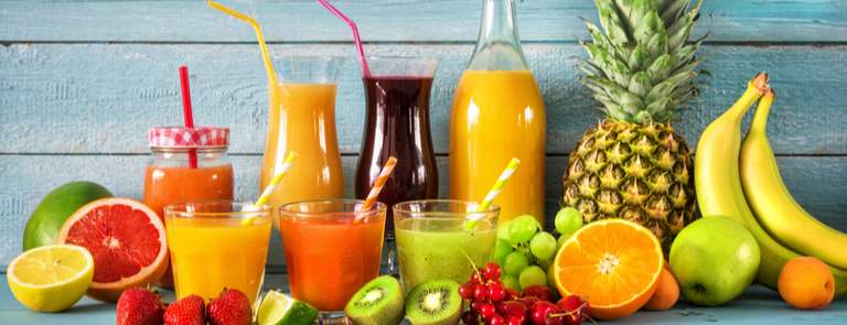 selection of fruit juices and fresh fruit