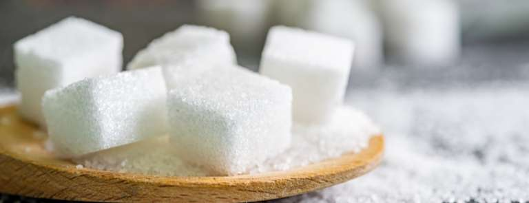 how much sugar should I have a day? sugar cubes on table