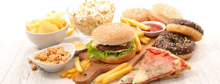 foods high in saturated fat burger, pizza, chips and doughnuts