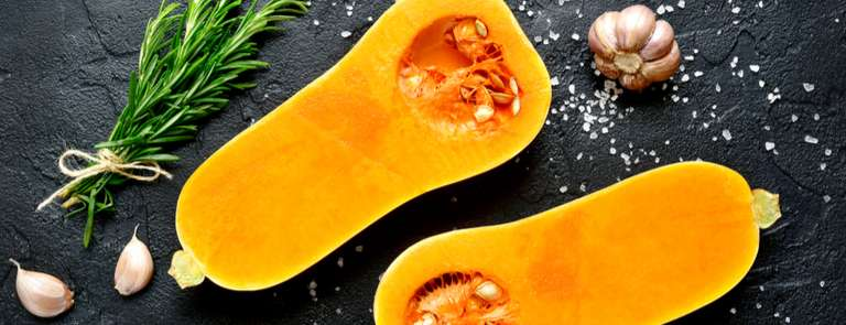 two halves of raw butternut squash sliced open