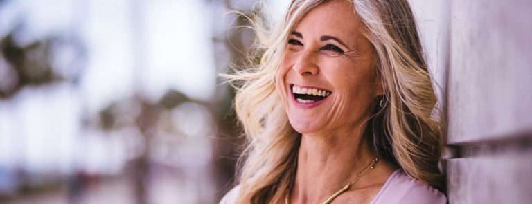 Happy middle-aged woman with greying hair