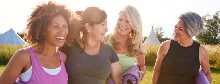 group of middle aged women with yoga mats