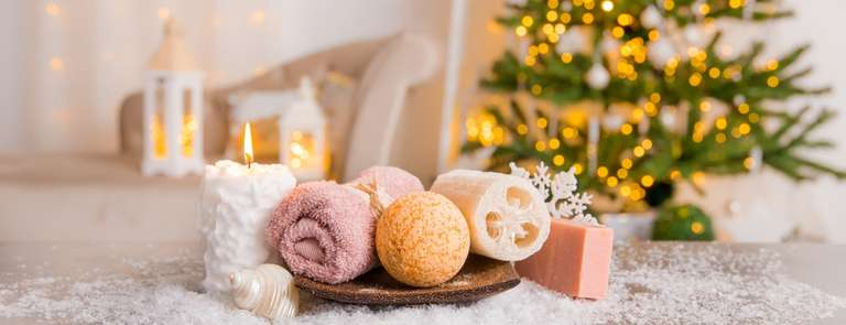 christmas self care gift with bath bombs and candles